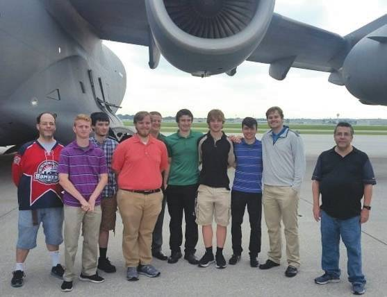 Submitted photo Members of the Wright State University hockey team and their assistant athletic director stand in front of a C-17 they toured on the first leg of their team-building tour of Wright-Patterson Air Force Base.