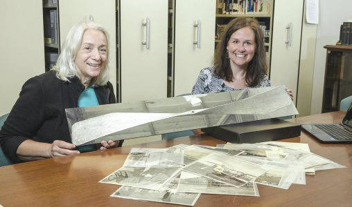 Submitted photo Dawne Dewey, head of Wright State's Special Collections and Archives, left, and archivist Toni Vanden Bos with a photo of a 1912 Wright Flyer propeller that the university had restored.
