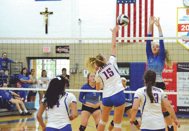 Greeneview's Ashley Schloss tries to block a shot hit by Carroll's Meredith Schock (15), Sept. 15, in a girls nonleague high school volleyball match at Carroll High School in Riverside.