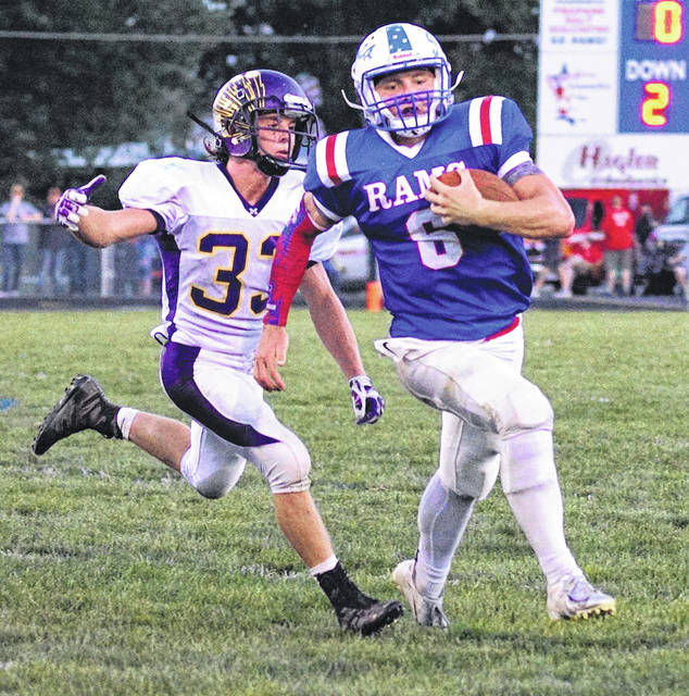 Greeneview quarterback Nick Clevenger carries the ball for a gain during first-half action Sept. 14 against Mechanicsburg, at Don Nock Field in Jamestown.