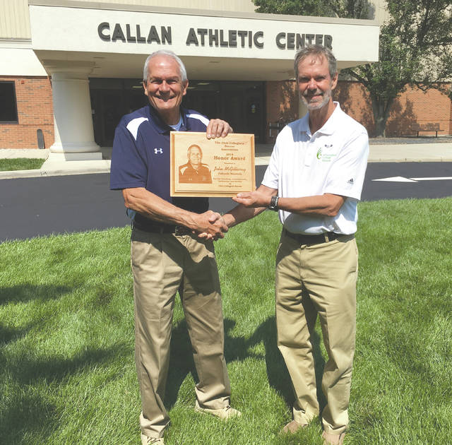 Longtime Cedarville University men's and women's soccer coach John McGillivray (left) was presented with the 2018 Honor Award from the Ohio Collegiate Soccer Association on Sept.4 in Cedarville. Making the presentation was longtime friend and OCSA Executive Committee member Bud Lewis, who just wrapped up a 43-year career coaching the men's soccer program at Wilmington College. The Honor Award is the OCSA's highest honor recognizing coaching, achievements, dedication and service to Ohio Collegiate Soccer. McGillivray was the Yellow Jackets men's coach for 24 years, and the women's coach for 18, in a storied 42-year career at Cedarville University.