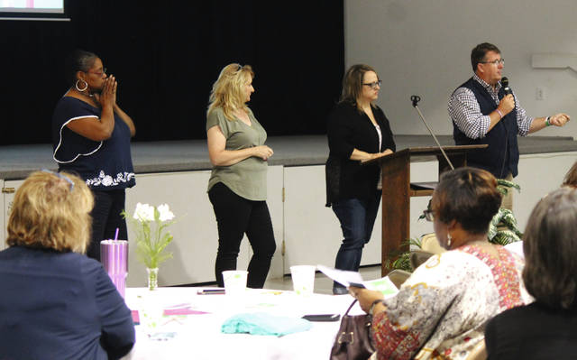 Anna Bolton | Greene County News Joyce Brown, human trafficking survivor; Beth Bullock, advocacy director for R.E.A.C.H. for Tomorrow; Amy Willmann, executive director for Safe Harbor House and Ohio Faith Net's Greg Delaney speak to a room full of people Aug. 27 at Emmanuel Baptist Church in Bellbrook.
