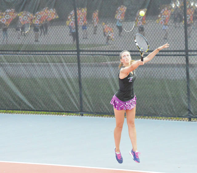Bellbrook senior Andrea Szep, shown here timing a high backhand shot from the baseline against Beavercreek, Sept. 18, has amassed an undefeated record at first singles.