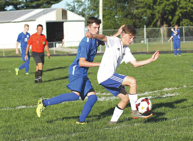 Maddix O'Bryant (right) of Xenia works to control the ball as Greeneview's Gavin Anderson defends, Sept. 15, in Jamestown.