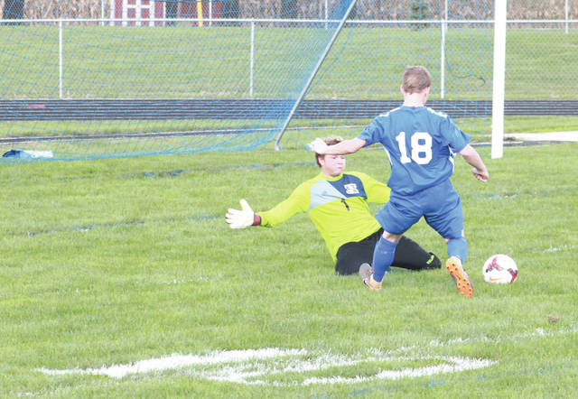 Xenia goalie J.T. Patterson stops a breakaway by Greeneview point leader Tyler Hurley early in the first half, Sept. 15 at Don Nock Field in Jamestown.