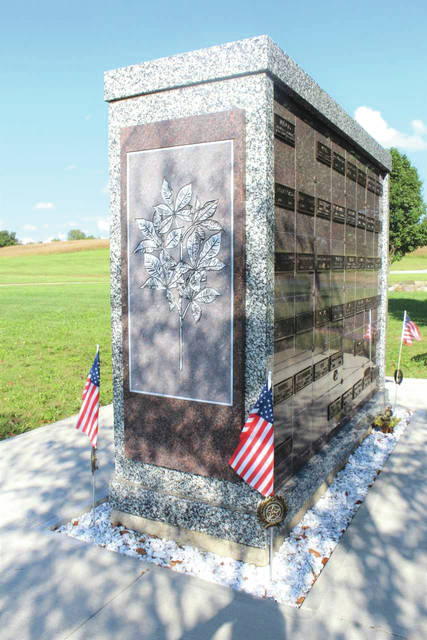 Linda Collins | Greene County News New plaque of etched Buckeye leaves mounted on columbarium helps patrons identify location of love ones remains.