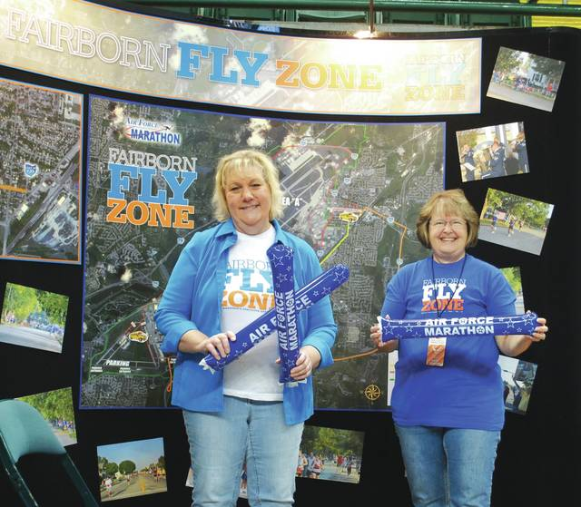 Whitney Vickers | Greene County News Linda Riffle and Debbie Butner lead the way in organizational efforts for the Fairborn Flyzone. They had a booth at the Sports and Fitness Expo as part of the Air Force Marathon activities.