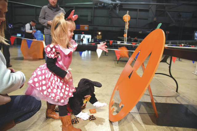 Submitted photo Museum visitors enjoying dressing up in costumes and learning about aerospace principles through Halloween-themed activities during Family Day at the National Museum of the U.S. Air Force.