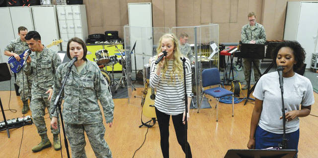 Submitted photo Singer Alexis Gomez, rehearses with the Air Force Band of Flight inside their offices at Wright-Patterson Air Force Base. Gomez, a country singer from the popular TV show American Idol will do a joint concert with the band on Oct. 13th.