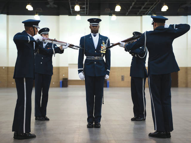 Submitted photo United States Air Force Honor Guard Drill Team performances feature a professionally choreographed sequence of show-stopping weapon maneuvers, precise tosses, complex weapon exchanges, and a walk through the gauntlet of spinning weapons. The Drill Team members perform over 100 times a year at various venues all over the world.