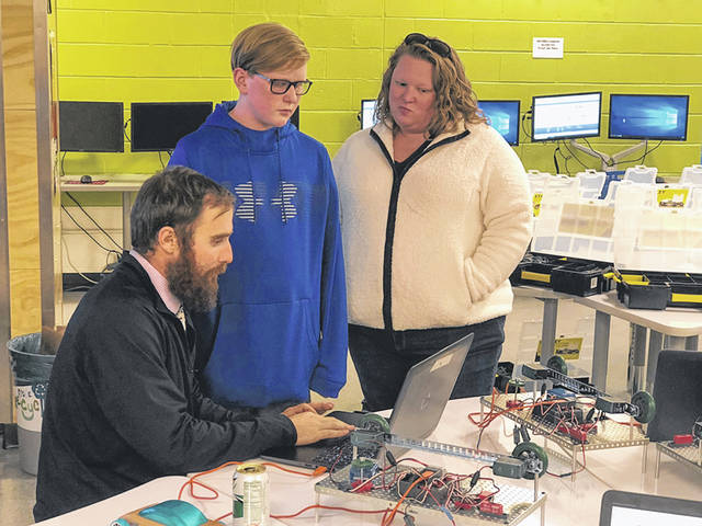 Submitted photo Coy Middle School teacher Brian Stevenson with a Beavercreek student and parent.