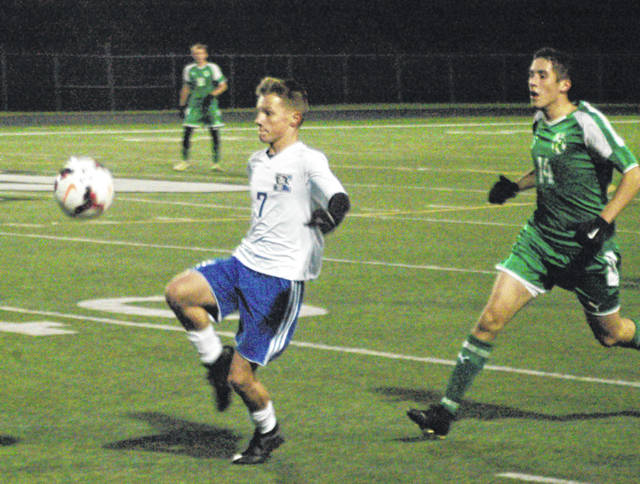 Brycen Heim (7) of Xenia tries to settle the ball in front of Northmont defender Justin Menker, Oct. 15 in a boys high school sectional first round game in Clayton.