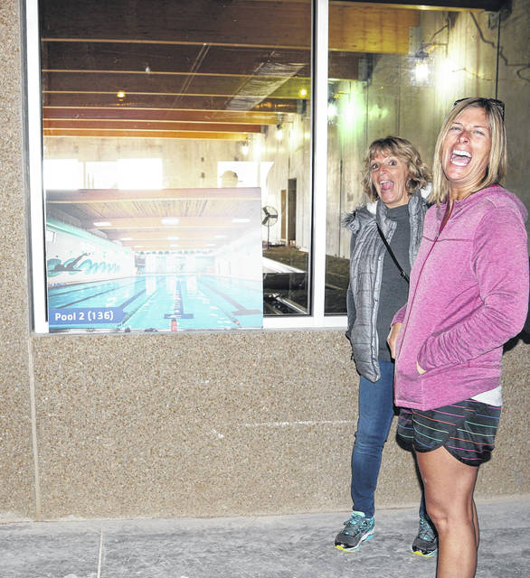 Two residents are excited over the prospect of a new YMCA with a large pool.