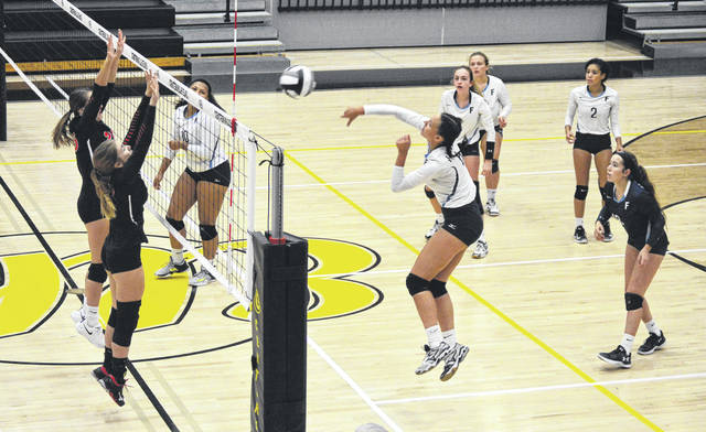Fairborn's LeeAnn Williams goes for a kill against West Carrollton during first round sectional volleyball action, Oct. 16 at Centerville High School.