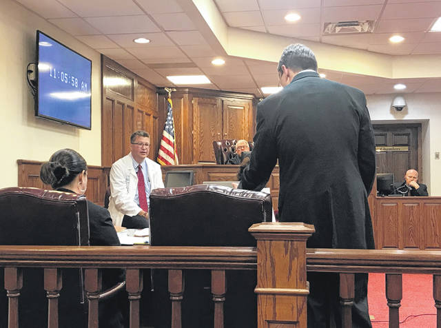 Anna Bolton | Greene County News Dr. David Soehner takes the stand Sept. 24 in Greene County Common Pleas Court to petition for permission to forcibly medicate defendant Michael McLendon to restore him to competency in order to stand trial. Assistant prosecutors Cheri Stout and David Morrison represent the state while Judge James Brogan listens.