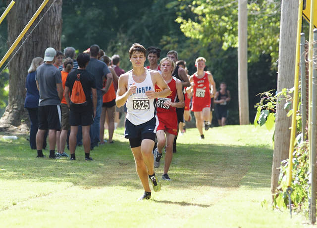 Logan Nelson of Legacy Christian Academy leads a group of runners down a trail, Saturday, Oct. 6 at the Legacy Christian Cross Country Invitational, in Xenia. Nelson finished 156th out of 287 runners in the boys high school field.