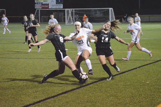 Centerville's Sydney White (8) and Kara Allen (14) double team Beavercreek scoring leader Marcella Cash (23), in the first half of an Oct. 10 girls high school soccer match at Legacy Stadium in Centerville. Cash assisted on two of the Beaver's three goals in the 3-0 Beavercreek win.