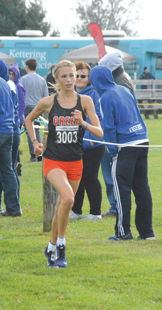 Beavercreek High School junior Taylor Ewert won the girls Division I cross country race in a time of 17 minutes,m 13.93 seconds, finishing nearly 30 seconds ahead of runner-up teammate junior Savannah Roark. Ewert, Roark and sophomore Juliann Williams finished first, second and fourth to lead the Battlin' Beavers to the girls D-I team win, Oct. 20 at Cedarville University.