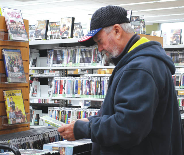 Patrons were found selecting books and movies. Some were browsing the web.