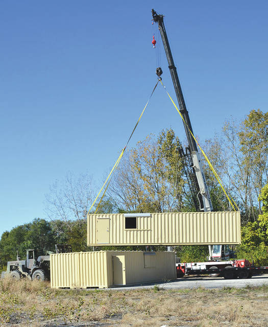 "Photo courtesy of WPAFB The National Center for Medical Readiness received delivery of a Conex ""hotel,"" Oct. 23 which includes three 12,000-pound structures, to be incorporated with future training and testing events taking place at the tactical training facility."