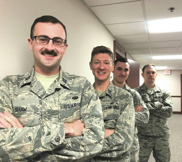 Submitted photo Left to right, Capt. Tim Shaw, Capt. John Lipscomb, Staff Sgt. Dakota Herndon and Tech Sgt. Matt Paris and from the 88th Air Base Wing Judge Advocates office, are growing mustaches in support of Mustache Movember. Movember is an annual event of growing mustaches during the month of November to bring awareness to men's health issues such as prostate, testicular cancer and mental health.