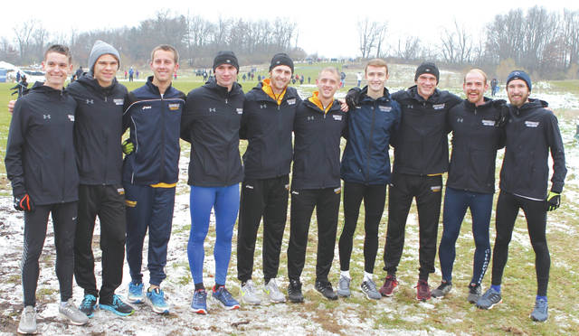 Members of the Cedarville University men's cross country team celebrate after placing fifth overall, Nov. 17, at the NCAA Division II Midwest Regional meet, in Hillsdale, Mich. The Yellow Jackets earned an at-large berth to the NCAA D-II national championship meet, which will be held Dec. 1 in Pittsburgh.