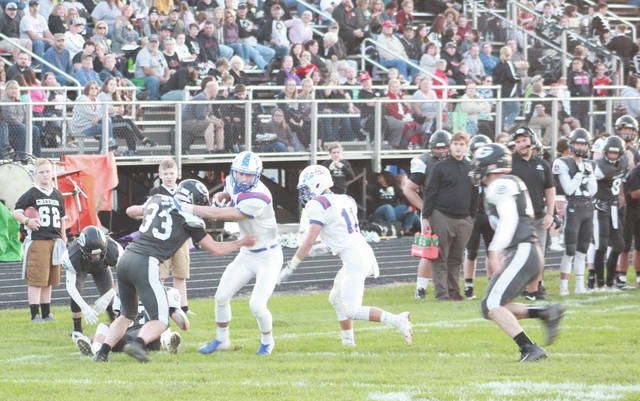 A large crowd looks on as Greeneview's Collin Wilson runs the ball against Greenon earlier this season. Chances are there will be a large contingent of Greeneview fans at Saturday's game in Chillicothe as well.