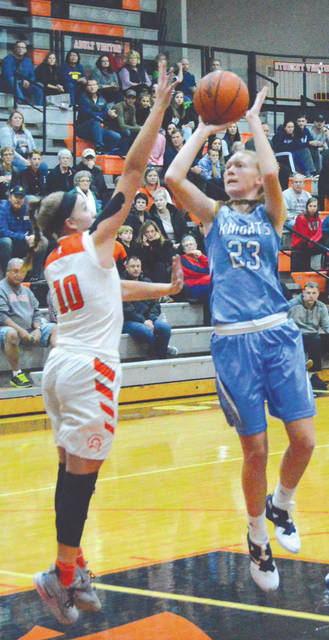 Legacy Christian's Emma Hess (23) puts up a shot over Waynesville's Leah Butterbaugh in the first half of Saturday's Nov. 24 girls high school basketball game at Waynesville High.