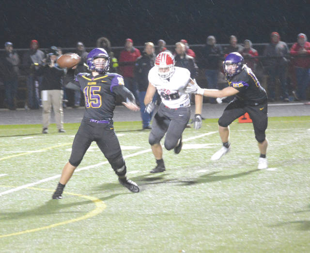 Bellbrook senior quarterback Brendan Labensky (15) fires a pass downfield in the first half of Friday's Nov. 2 Division III high school football game against Thornville Sheridan.