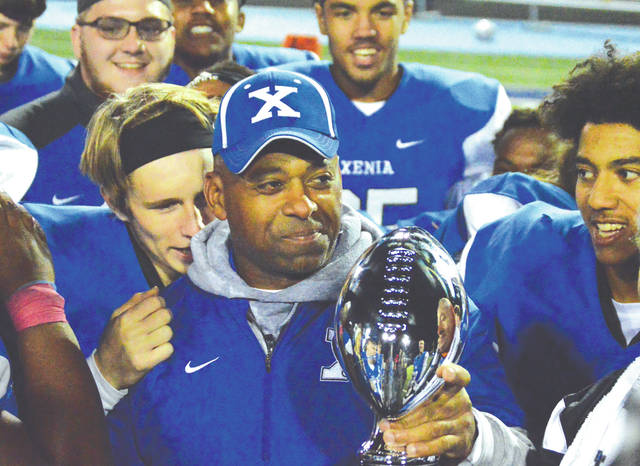 Xenia head football coach Trace Smitherman smiles after being handed the Thursday Night Lights football trophy, Oct. 25 at Doug Adams Stadium. Smitherman was named the OHSAA Southwest District Division II Coach of the Year on Nov. 15 by a panel of area sports writers.