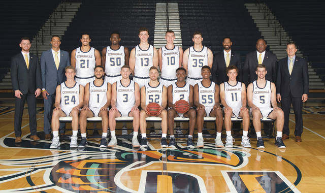Members of the 2018-19 Cedarville University men's basketball team are (seated left-to-right): Cameron Roseman, Demond Parker, Colton Linkous, Grant Zawadzki, Branden Maughmer, Quinton Green, Anthony Chaffey, Isaiah Speelman. (Standing): Assistant Coach Aaron Horn, Assistant Coach Patrick Bain, Gabriel Portillo, Robert Okoro, Seth Dittmer, Kollin Van Horn, Conner TenHove, Assistant Coach Dr. Anthony Moore, Assistant Coach Terry Futrell, Head Coach Pat Estepp.