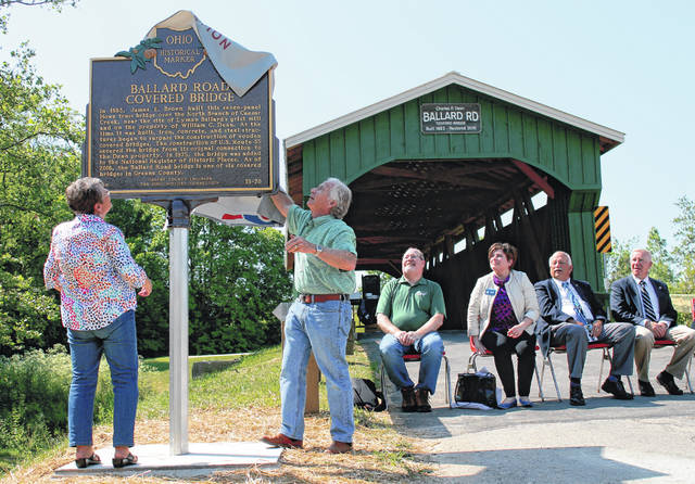 Anna Bolton   Greene County News Greene County Engineer Bob Geyer and Peggy Dean, wife of the late Charles F. Dean, remove the cover from the Ballard Bridge's historical plaque June 9, 2017 at the dedication ceremony.
