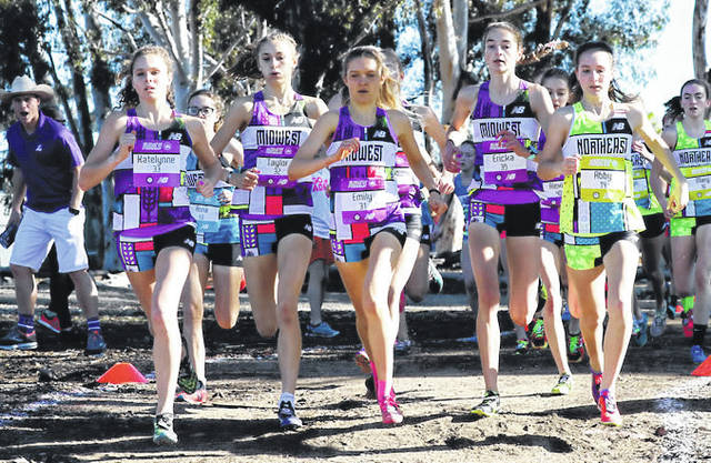 Photos courtesy PhotoRun.net Beavercreek's Taylor Ewert (second from left) and three of her midwest teammates lead the group during the Foot Locker Cross Country Championships National Finals, Dec. 8 in San Diego.