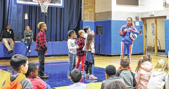 "Photo courtesy of WPAFB Globetrotter ""Hoops"" Green talks to kids about bullying prevention at the Wright-Patterson Air Force Base Child Development Center."