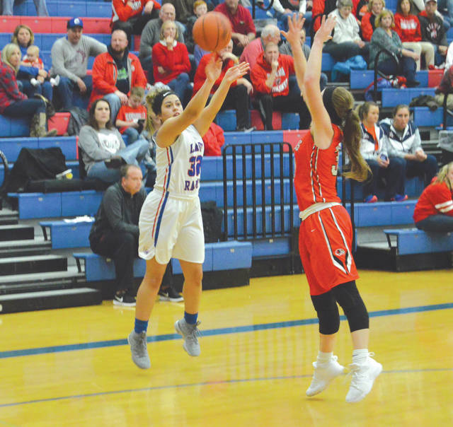 Greeneview senior guard Kenzie Harding (32) puts up a three-point shot against Cedarville's Maggie Coe, in the first half of Thursday's girls high school basketball battle in Jamestown. Harding led the host Rams in scoring with 13 points, while Coe led Cedarville with 12.