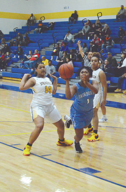 Fairborn's Khala Powell puts up a shot after being fouled by Springfield's Camaya Calloway, in the first half of Thursday's Dec. 27 girls high school basketball game at Springfield High.
