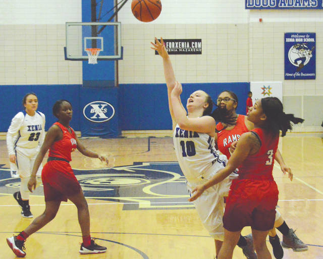 Kamea Baker puts up a shot in the first half of Wednesday night's girls high school basketball game at Xenia High.
