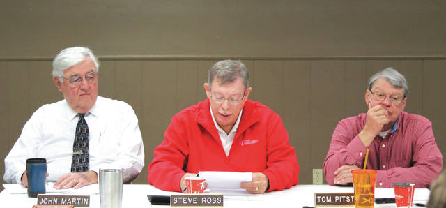 Linda Collins | Fairborn Daily Herald Bath Township Trustees John Martin, Steve Ross and Tom Pitstick Dec. 3 during a special meeting.
