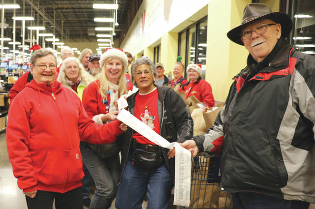 Submitted photos Chapter F members of the Fairborn Gold Wing Road Riders Association recently met up to grocery shop for 12 local senior families in need. Members are connected with families from the Fairborn Christmas project, then phone the families asking about their special diet needs, how many to feed, pet needs and their wants for the grocery delivery so they get foods they like and can use.