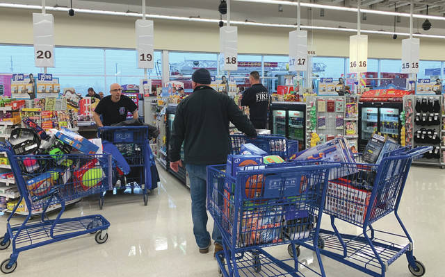 Submitted photos Fairborn firefighters, in partnership with several community entities, recently hosted a Christmas Toy Drive that resulted in more than $10,000 worth of donations.