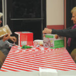 Families create gingerbread houses