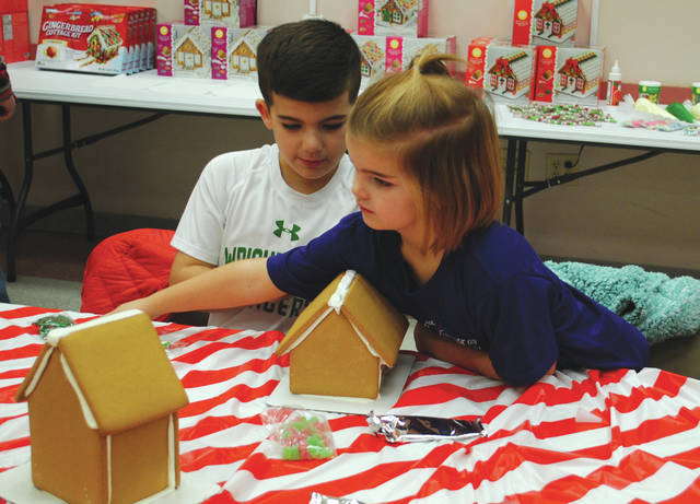 Whitney Vickers | Greene County News Fairborn Parks and Recreation recently hosted a gingerbread-making event and invited families to the Fairborn Senior Center to get creative. Fairborn parks offered all the needed supplies.