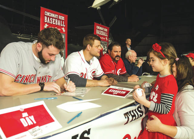 Submitted photo Members of the Cincinnati Reds organization will meet with visitors of the National Museum of the United States Air Force from 11 a.m. to 2 p.m. Saturday, Jan. 19. Pictured is pitcher Cody Reed signing an autograph for a fan in 2016. He will be one of the Reds returning to the museum again this year.