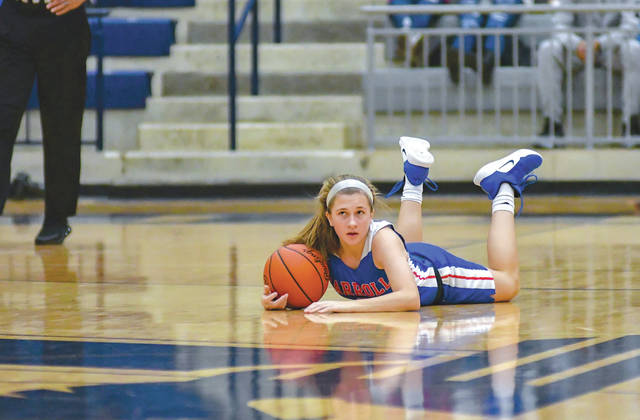 Carroll freshman guard Sarah Ochs falls on a loose ball in a Jan. 28 overtime win over Fairmont at Kettering's Trent Arena.