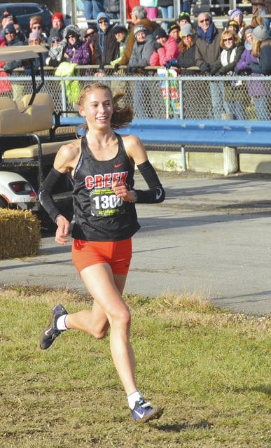 Beavercreek junior Taylor Ewert, shown winning the Division I state cross country championship race last fall, was named the Gatorade Ohio Girls Cross Country Runner of the Year on Jan. 28.