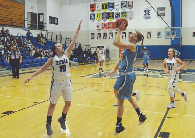 Legacy Christian's Emily Hess puts up a shot against Xenia's Kamea Baker, in the first half of Monday's Jan. 28 girls high school basketball game at Xenia High School.