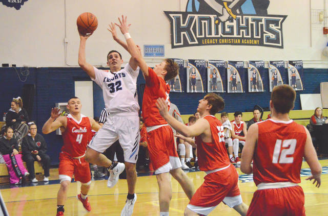 Legacy Christian senior forward Erik Uszynski (32) puts up a first-half shot in a Jan. 31 boys high school basketball game against visiting Carlisle. Uszynski led all scorers with 17 points in the Knights win.