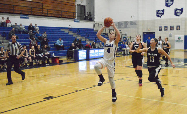 Xenia's Haley McManus scores a breakaway layup in the first quarter of Thursday's girls high school basketball home game Jan. 3 against Graham.