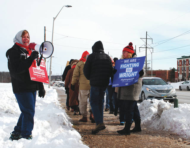 Whitney Vickers | Greene County News Members of the American Association of University Professors - Wright State University Chapter, as well as some students and graduates formed a picket line Jan. 22 on the sidewalks leading up the Dayton campus in protest of the university's contract terms for faculty members.