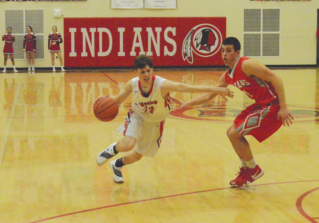Cedarville's Colby Cross and Southeastern's Charlie Bertemes battled throughout Friday's Ohio Heritage Conference boys high school basketball game at Cedarville High. Cross led the Indians with 14 points, while Bertemes led all scorers with 20.